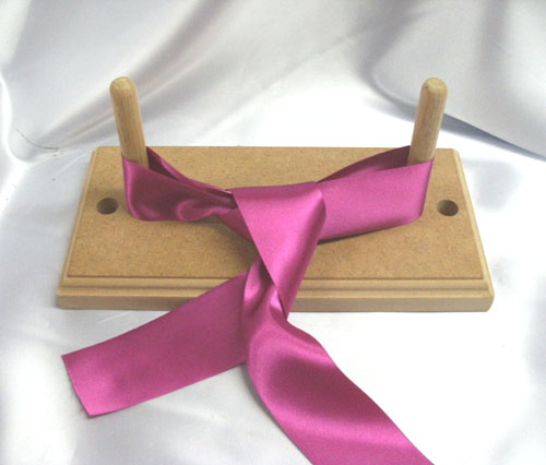 Ribbon Bow Maker http://www.swiftbox.co.uk/bow%20maker.htm